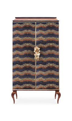 Divine armoire by Kokete | KOKET brings an earthy vibe predicted by the Fall/Winter Fashion Weeks to High Point Market in Inter Hall location IH 409. Discover more: http://www.bykoket.com/events/high-point-fall-2015.php #hpmkt #hkpmt2015