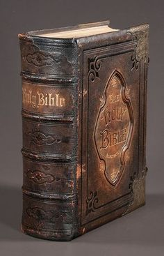 Embossed leather bound Bible with gold tooling and engraved brass mounts with black and white plates, dated 1878.