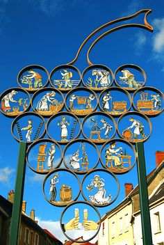 Wrought iron sign illustrating the cycles of champagne production in Chatillon sur Marne. Pub Signs, Shop Signs, Storefront Signage, Growing Grapes, Advertising Signs, Street Signs, Hanging Signs, Wine Drinks, Sign Design