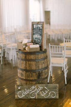 Adorable barrel and wood sign entrance table