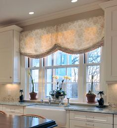 Beautiful Relaxed Roman Shades In A Kitchen Window Adds Softness And Retains The View