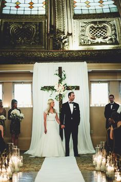 wedding backdrop with the cross / http://www.deerpearlflowers.com/christian-wedding-corss-ideas/