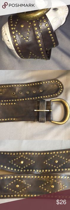 Dark Brown & Brass Faux Leather Studded Belt Faux Leather Studded Dark Brown & Brass Belt. Well loved belt with a lot of life left in it!  Brass stuffed all around and on the middle they are making diamond shapes with another stud in the middle.  Measures approx 47.5 inches long, the buckle holes are at approx 40.5-44.5 inches and 3 inches wide. There's a few marks on it, pls see picks. Checkout my other listings and add to a bundle to save!  Brass & dark brown Studded & Faux Leather Belt.nm…