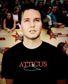 Mark Hoppus of Blink-182, awesome Atticus teeshirt!!