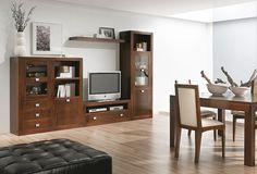 Muebles de salón - comedor realizados en madera de nogal americano. Medidas totales 319x40x209 cm.