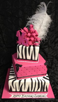 Three tier Sweet 16 Cake with zebra print, quilted hot pink with black swiss dots, large loopy bow with 16 and feather. Cake is red velvet with white chocolate ganache filling frosted in vanilla buttercream. Sweet Sixteen Cakes, Sweet 16 Cakes, Sweet Sixteen Parties, Pretty Cakes, Cute Cakes, Beautiful Cakes, Amazing Cakes, Unique Cakes, Creative Cakes