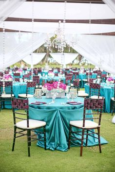 Exotic turquoise and pink tablescape, created by Passion Roots, Hawaii Wedding Florist. www.passionroots.com