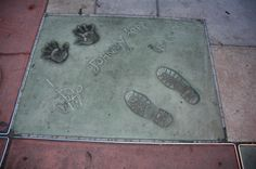 Johnny Depp is everywhere when we and our Elite Adventure Tours guests arrive at Grauman's Chinese Theater in Hollywood as a part of a custom private tour of Los Angeles. Handprints, his Walk of Fame star, his Madame Tussaud's figure and several live characters are all right here in one place.