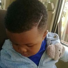 Cute Black Baby boy... Little man showing off new haircut <3