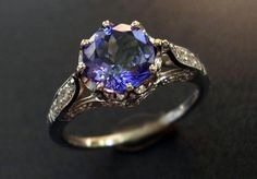1.37 Carat Tanzanite Ring Set in 14kt White Gold Surrounded by Diamonds