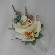 WEDDING FLOWERS -LADIES CORSAGE IN CREAM ORCHIDS