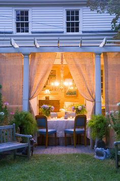 The curtains add a touch of privacy to the outdoor patio
