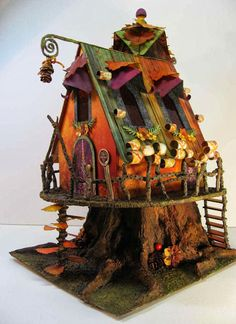 craft knife chronicles: Autumn Fairy House. Laura Denison of Following the Paper Trail decided to showcase her Autumn Fairy house pattern with this paper collection lauradenisondesigns.com