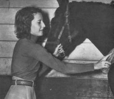 0 Barbara Stanwyck tends to a horse at Marwyck
