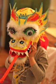 You have to have a Chinese Dragon Mask for Chinese New Years. Use it as a centerpiece.