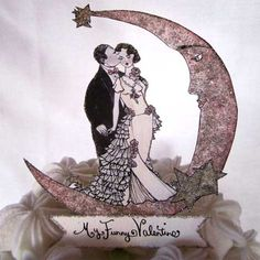 PAPER, custom-designed wedding cake toppers!  They're so unique and could be kept in a scrapbook or photo album!