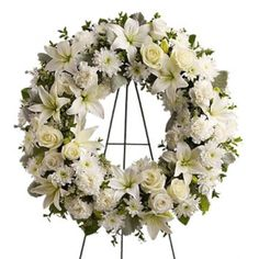 Looking for flower wreaths or a funeral flower wreath? Honor those you lost with a beautiful sympathy floral wreath arrangement. We specialize in creating traditional flower wreath arrangements for funeral, memorial, church services and the home. Flowers For Funeral Service, Funeral Flowers, Funeral Floral Arrangements, Flower Arrangements, White Wreath, Floral Wreath, Lighted Wreaths, Corona Floral, Cemetery Flowers