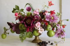 By Pia Jane. Hellebores, blackberries, green apples, ferns, tiny roses, Cosmos,  foxglove, poppy seed pods, poppies?, etc.