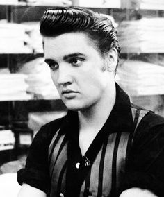 Elvis at the Lansky Brothers Clothing Store on Beale Street, Memphis, June 1956.