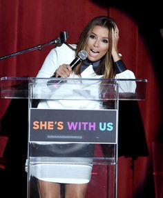 Eva Longoria stepped out in a sleek white collared dress to show her support for Hillary Clinton.