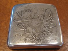 Black Starr & Frost sterling silver cigarette case with acid-etched moose and hunting motif, c1895 (nceantiqueswntd)