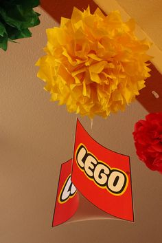 Make Lego mobile hanging sign using three copies of the Lego logo printed on card stock.