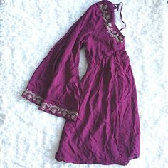 BNWOT. Purple Boho dRess BNWOT. Never been worn. too cute but didnt fit me in the breast area and threw away the receipt. The dress has a deep V cut w embroidery design in the front. super low back to the waist. gartered at the back waist area. flare sleeves , length is just perfect. fully lined. bust measures 14 inches ( measured from the back , tied armpit to armpit) Dresses