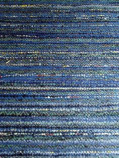 Blue rug by imcarmel, via Flickr, double rosepath threading, pick of black rug warp in between rag picks: