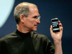Apple Computer Inc. Chief Executive Officer Steve Jobs holds the new iPhone in San Francisco, California January 9, 2007 REUTERS/Kimberly White