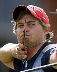 Brady Ellison of the U.S. takes aim during the men's archery team quaterfinals at the Lords Cricket Ground during the London 2012 Olympics Games July 28, 2012. REUTERS/Suhaib Salem (BRITAIN - Tags: SPORT OLYMPICS SPORT ARCHERY)