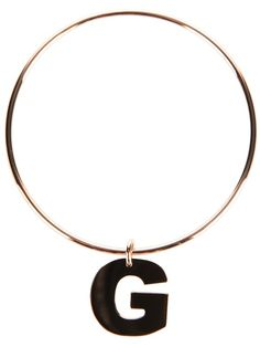 Gold plated silver bracelet from Maman et Sophie featuring a solid circular band and a 'G' charm detail.