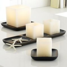 Candle Lantern Cubes modern candles and candle holders.