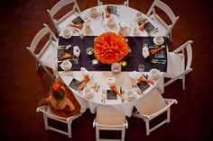 Nice idea to use a runner on a round table and a pouf as the centerpiece *looks good from above...kinda fun.