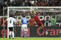 Italy's Buffon makes a save as Germany's Khedira and Italy's Bonucci run up during their Euro 2012 semi-final soccer match at the National Stadium in Warsaw. PASCAL LAUENER/REUTERS