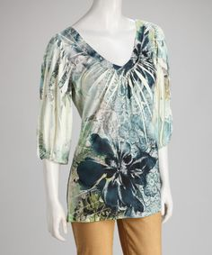 Take a look at this Teal & White Floral Sublimation Cutout Top by Simply Irresistible on #zulily today!