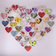 Cut out various paper hearts, decopage to canvas