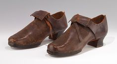 Men's shoes, 1725 -50 The general cut, fold-over tongue, and substantial heel are retained from fashionable shoes of a somewhat earlier date, while the heavy, pegged soles and heel irons indicate that the primary intent of these shoes was not for up-to-date style but for their capacity to stand up to the rigors of work in the pre-industrial society.