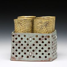 Sunshine Cobb  Description:hand built mid-range red clay and glazeDimensions:6.5x7.25x7.25