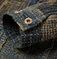 Beautiful detailing and aged button patina by Kapital for their 'Boro' Jacket.
