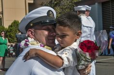 131122-N-XD424-148 PEARL HARBOR  (Nov. 22, 2013) A Sailor assinged to the guided-missile cruiser USS Chosin (CG 65) hugs his son after the ship pulled in to its homeport of Joint Base Pearl Harbor-Hickam following a deployment to the Western Pacific.  (U.S. Navy Photo by Mass Communication Specialist 2nd Class Dustin W. Sisco/Released)