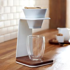 $150 Starbucks pour over coffee stand corian and walnut