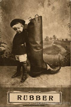 Child Standing Next to Same Sized Rubber Boot Children