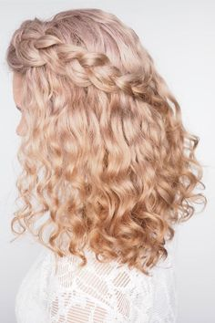 Half-Back with a Braid | Put the flat iron down. If you have naturally curly hair, there's no need to take a straightener to your beautiful curls on your wedding day. These curly wedding hairstyles are pretty, easy, and showcase the beauty of natural curls. Fun accessories like flowers or a veil will add a touch of personality, or you can let the curls shine on their own with an elegant updo or half-up style. You'll be able to embrace the Southern humidity and face the weather of the day…