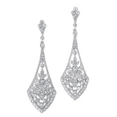 "These bridal earrings are what make vintage wedding jewellery so popular! They boast a jewel-encrusted flare design rich with inlaid CZ stones. These dramatic silver rhodium plated earrings measure 2 ¾"" high for an eye-catching wedding accessory. These earrings are available in your choice of silver rhodium plated or 14K gold plated."