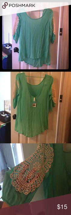 3/4 sleeve hi/low shirt Mint 3-4 sleeve hi/low shirt with crochet cutout sleeves. Low back for an extra feminine look. Saga Tops Blouses
