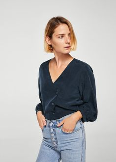 MANGO presents you its new collection. Have a look at our online catalogue and discover the latest fashion trends surfing along the jeans, T-shirts and . Blouse Wrap, V Neck Blouse, Mango Outlet, Shirt Blouses, Shirts, Crossover, Latest Fashion Trends, Blouses For Women, Cool Style