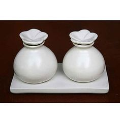 White ceramic oil bottles and tray from World Market.