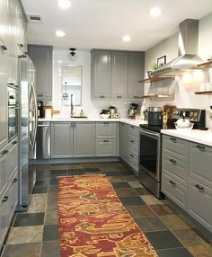 Bodbyn Grey IKEA kitchen.  white quartz countertops.  White subway tile.   Matte black hardware.