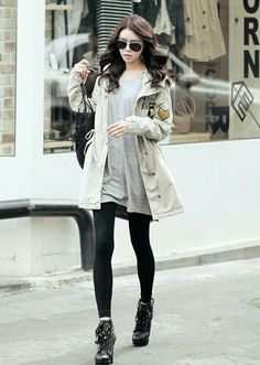 Army jacket over a grey shirt and tights