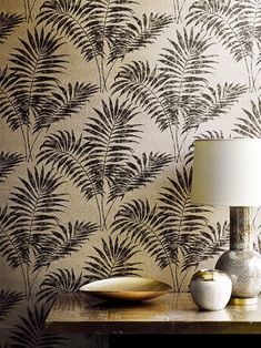 This textured palm wallpaper design makes a really lavish statement with a combination of subtle metallics and fine detailing in the background.